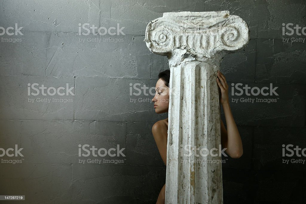 Woman with column royalty-free stock photo