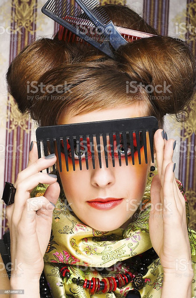 Woman with combs. stock photo