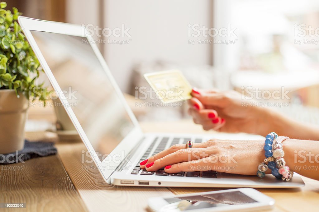 Woman with computer shopping online stock photo