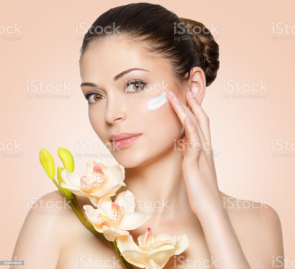 woman with cosmetic cream on face stock photo