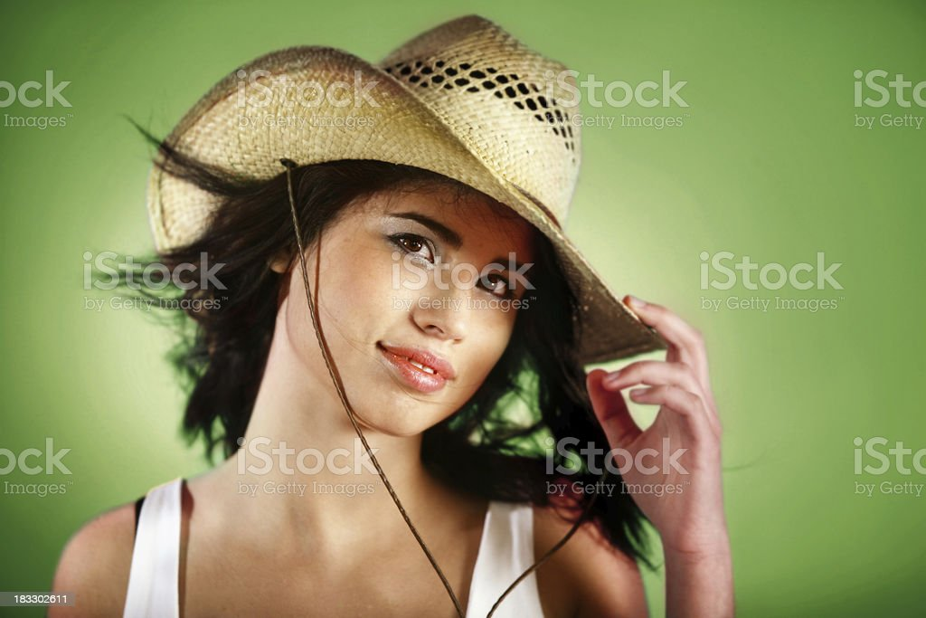 Woman with cowboy hat on green royalty-free stock photo