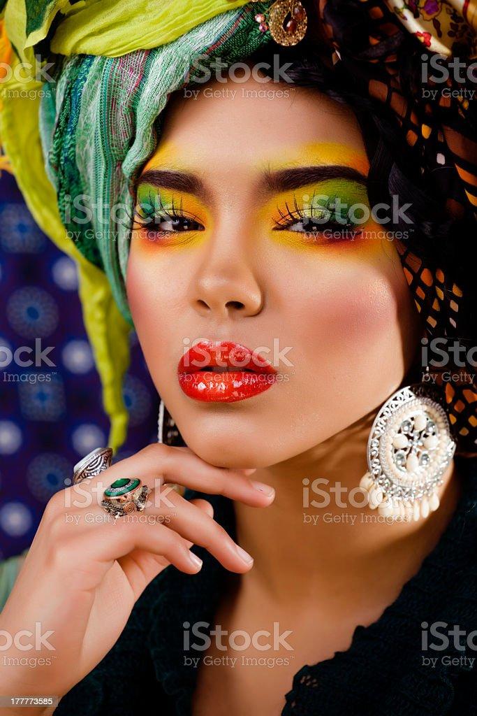 woman with creative make up, many shawls on head royalty-free stock photo