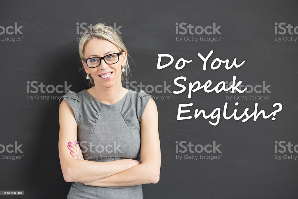 Woman with crossed hands promoting english courses stock photo