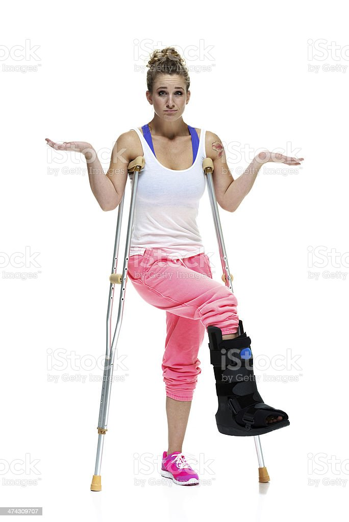 Woman with crutches royalty-free stock photo