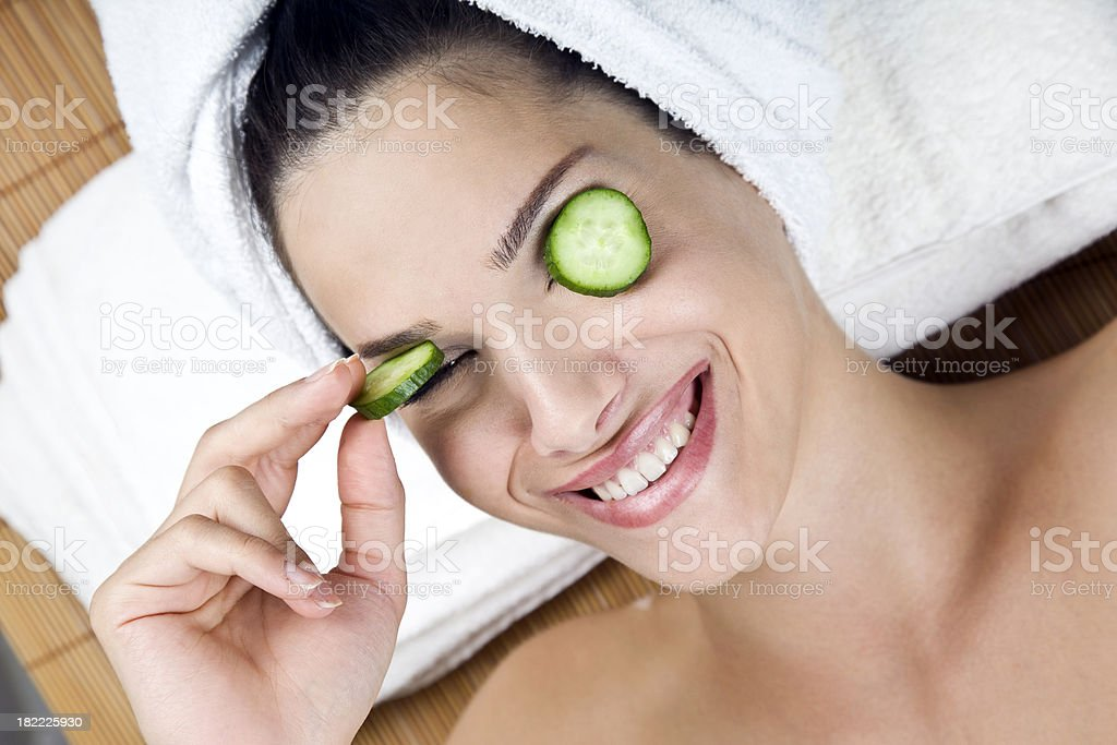 Woman with cucumbers on eyes royalty-free stock photo