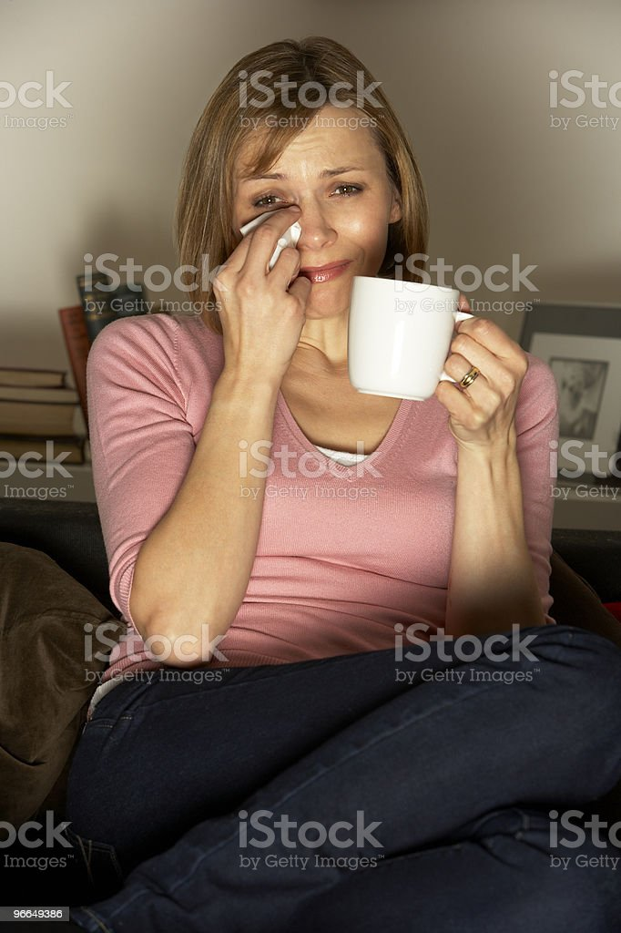Woman With Cup Of Coffee Watching Television stock photo