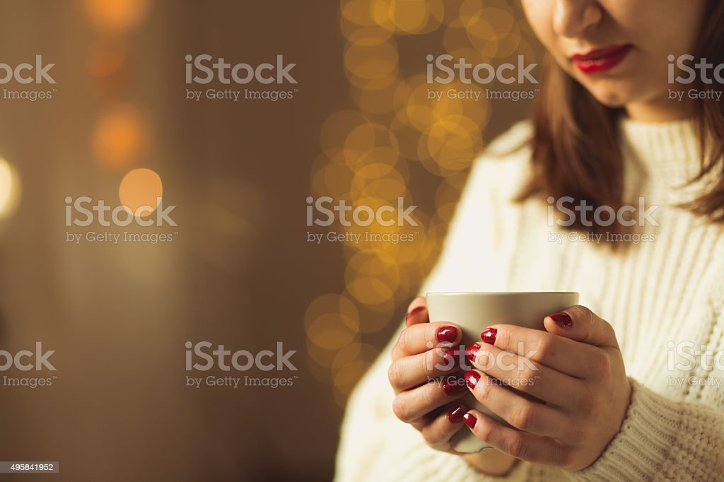 Woman with cup of tea stock photo