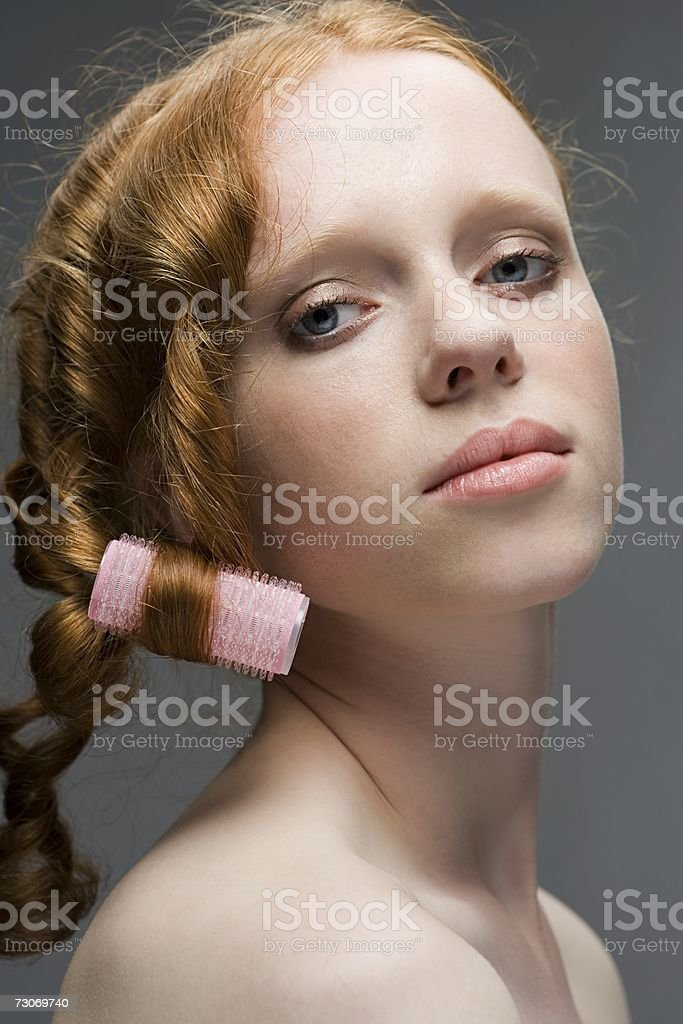 Woman with curler in her hair royalty-free stock photo