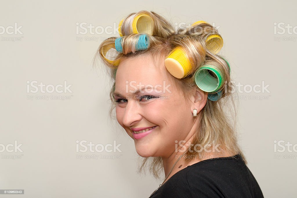 Woman with curler stock photo