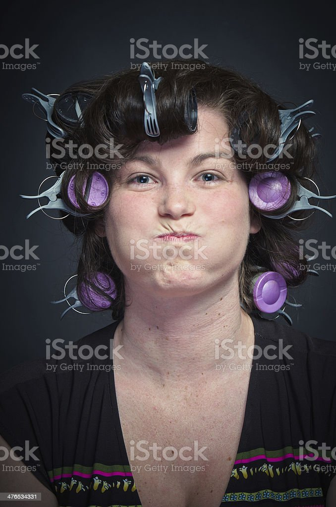 Woman with Curlers making a face royalty-free stock photo