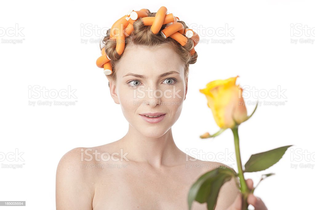 woman with curlers receiving yellow rose royalty-free stock photo
