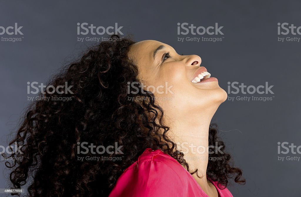 woman with curly hair looking up royalty-free stock photo