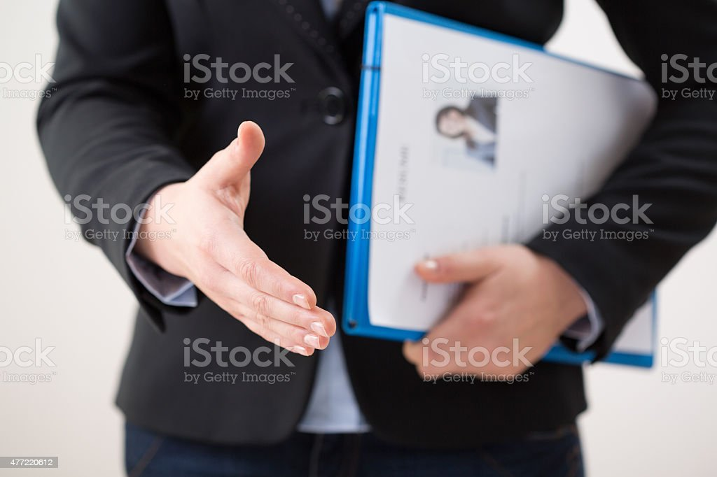 Woman with curriculum vitae stock photo