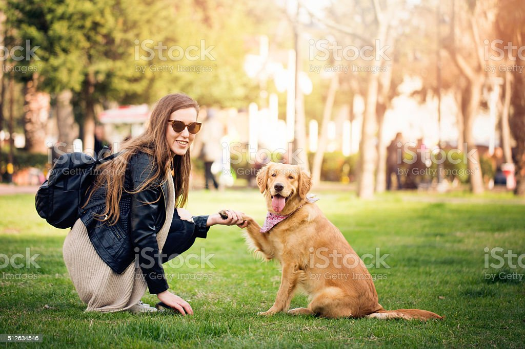 Woman with cute dog stock photo