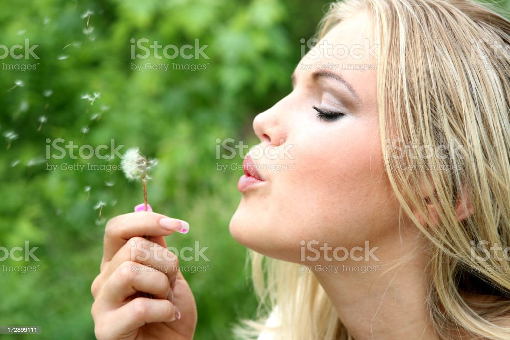 woman with dandelion royalty-free stock photo