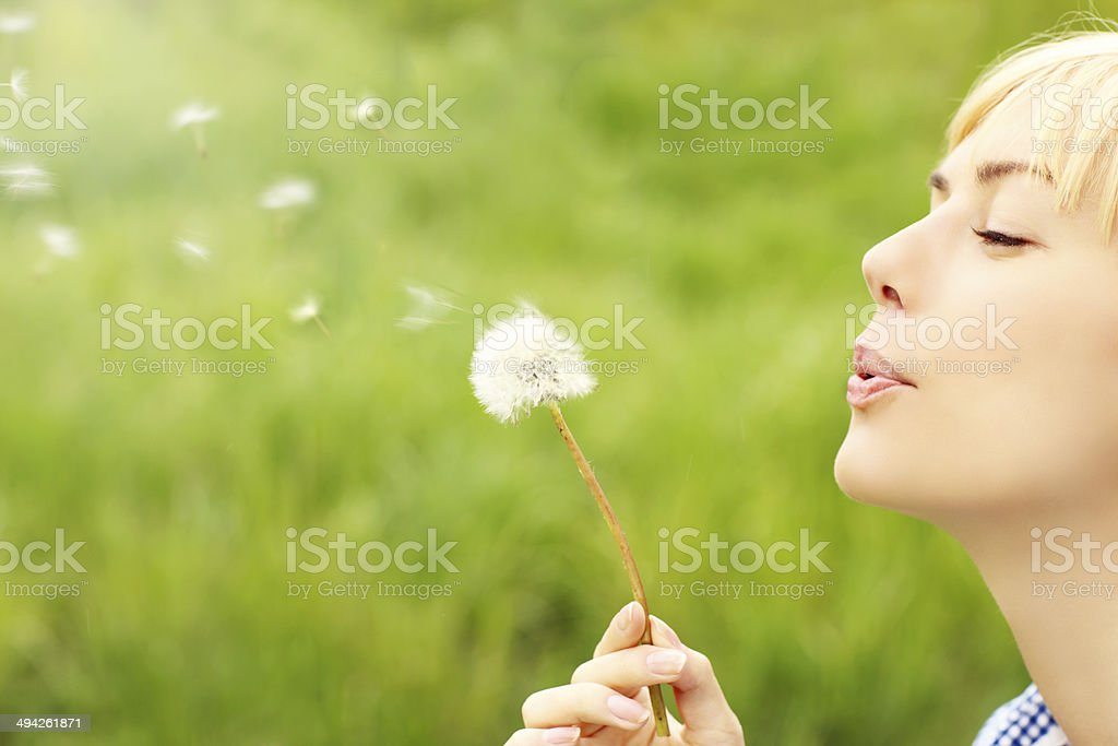 Woman with dandelion stock photo