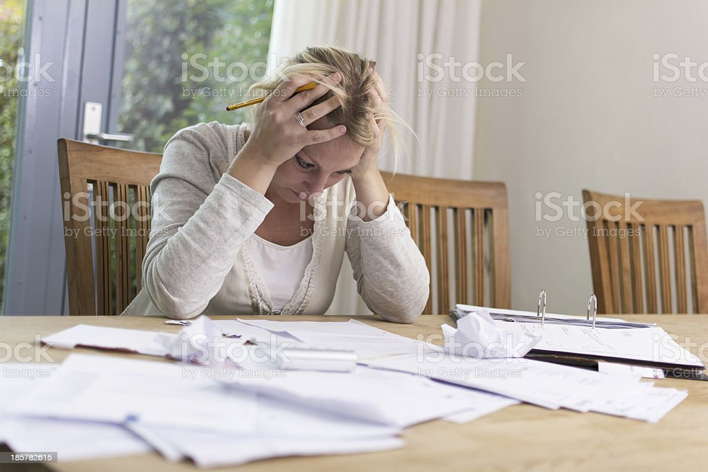 Woman with debts stock photo
