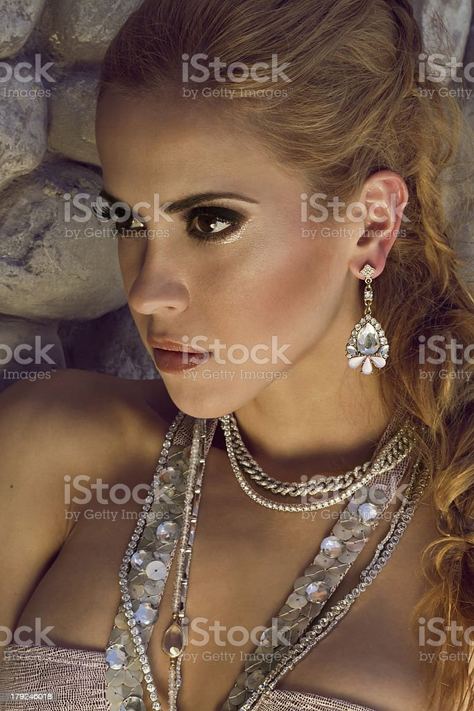 Woman with diamond earring royalty-free stock photo