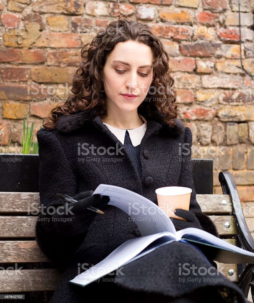 woman with diary and coffee royalty-free stock photo