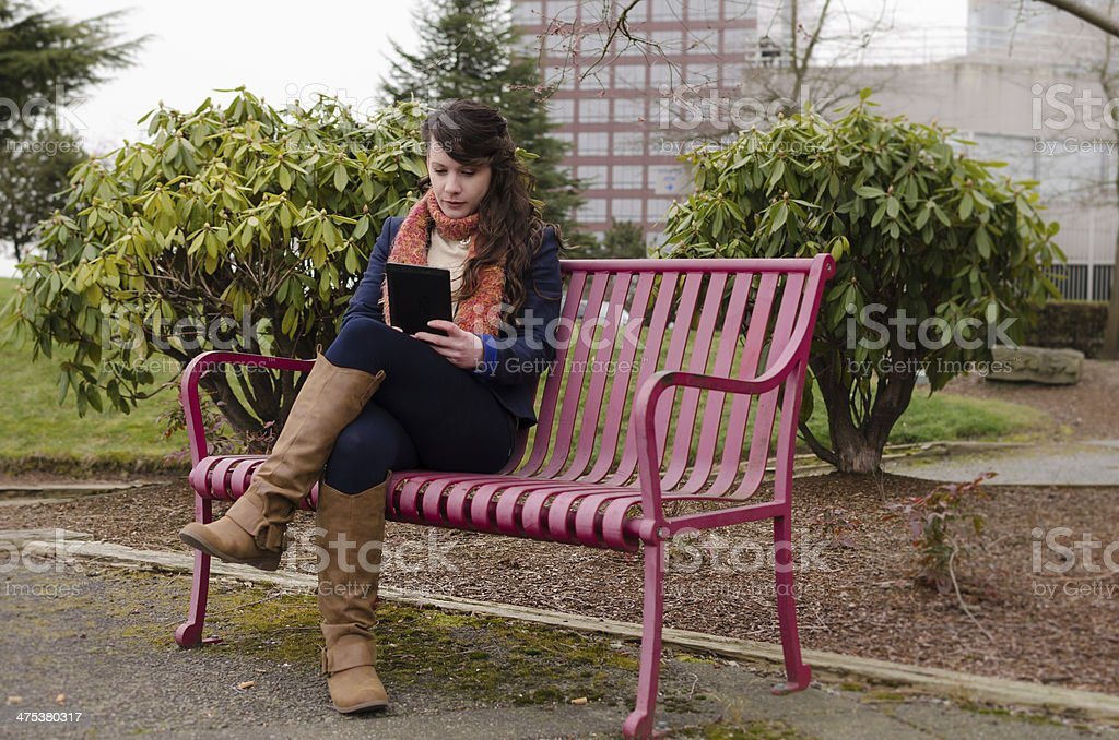 Woman with digital device stock photo