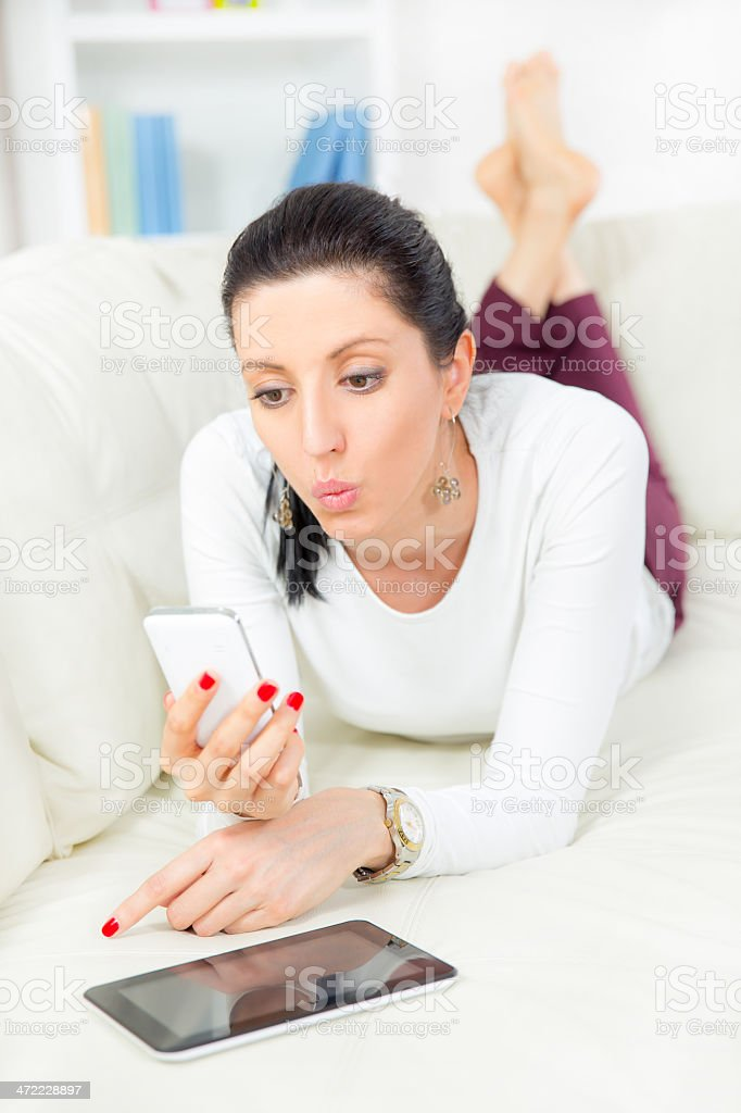Woman with digital tablet and smartphone stock photo