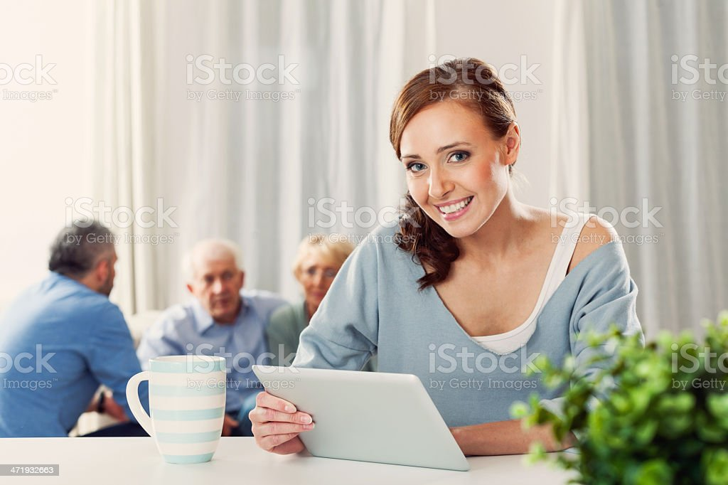 Woman with Digital Tablet at Home royalty-free stock photo