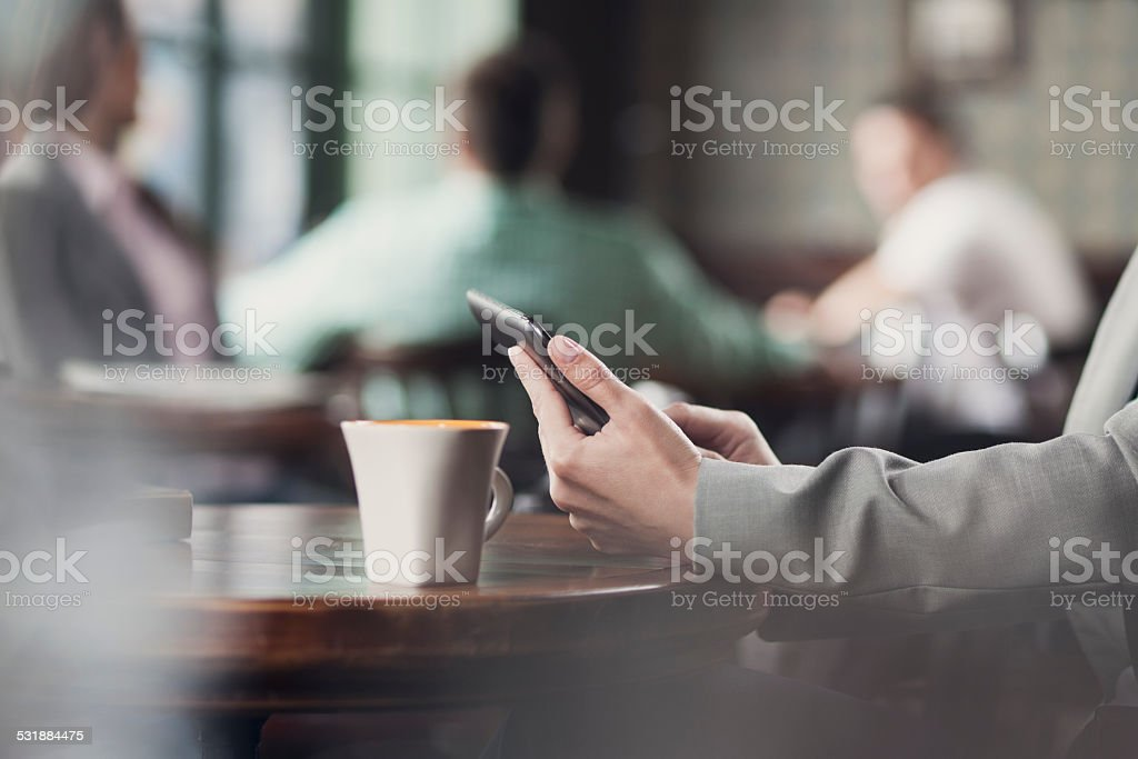 Woman with digital tablet in cafe stock photo