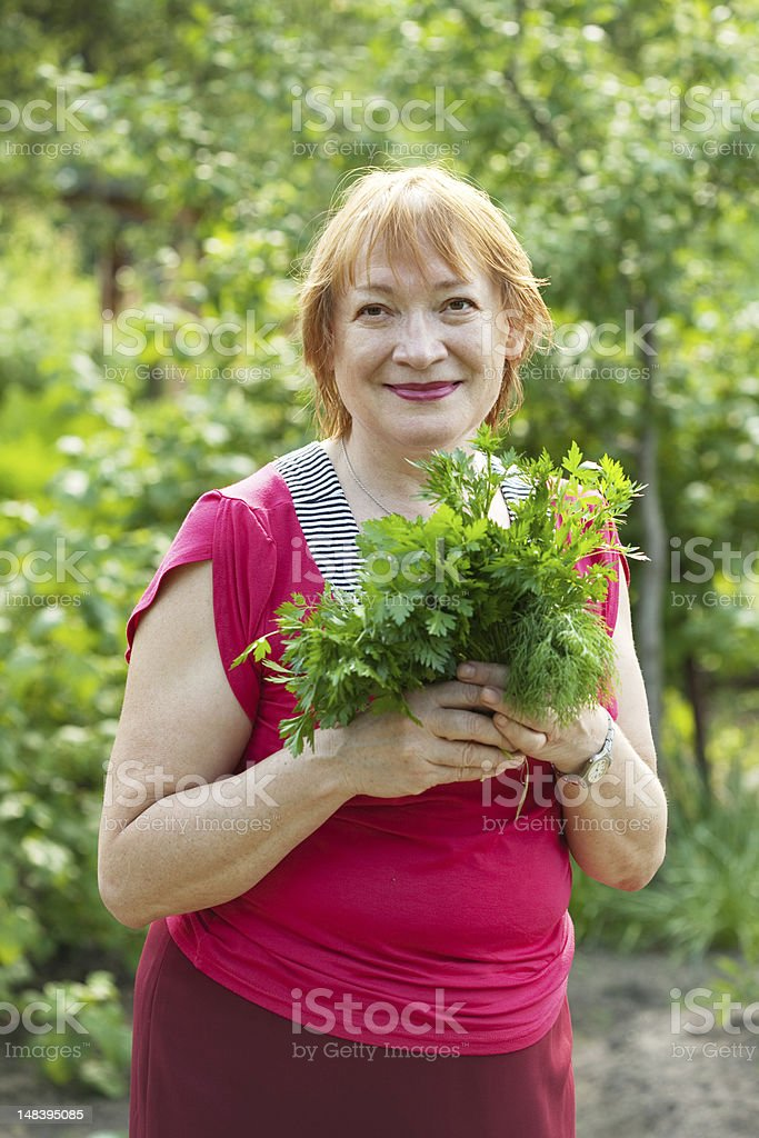 woman with  dill and parsley royalty-free stock photo