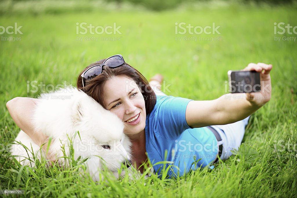 woman with dog in the park royalty-free stock photo