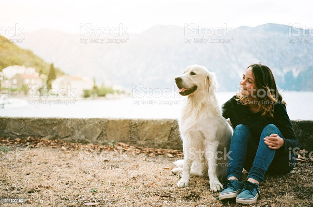 Woman with dog near the Kotor Bay stock photo