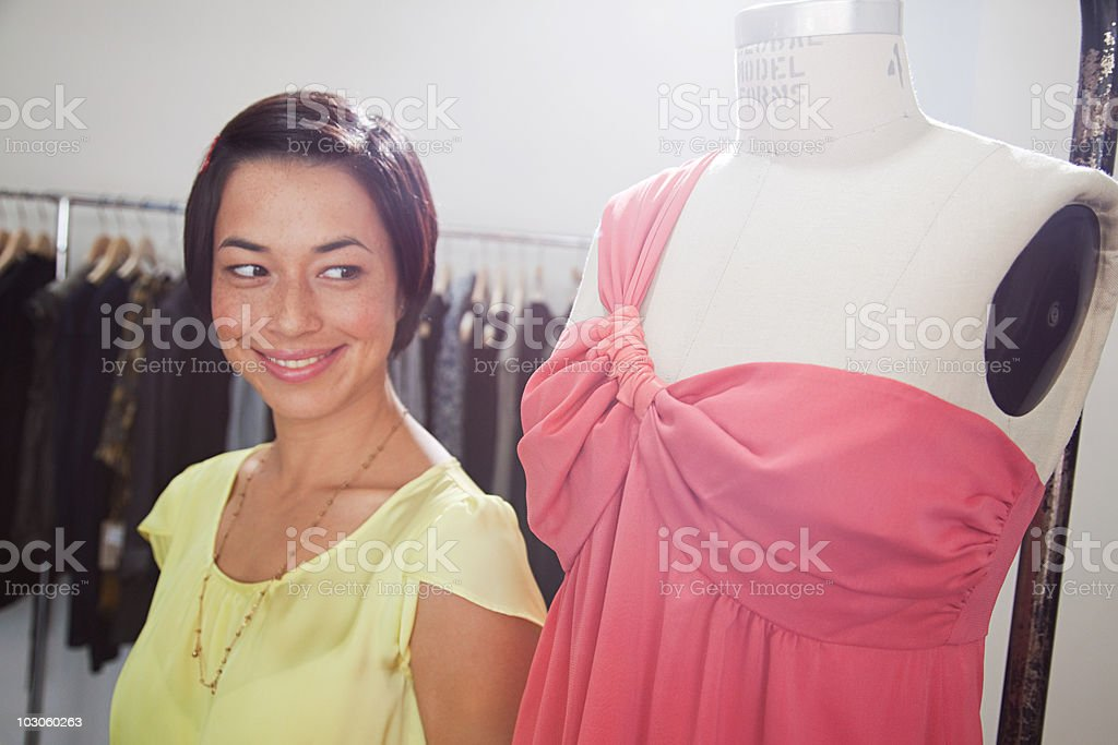 Woman with dress on mannequin in boutique royalty-free stock photo