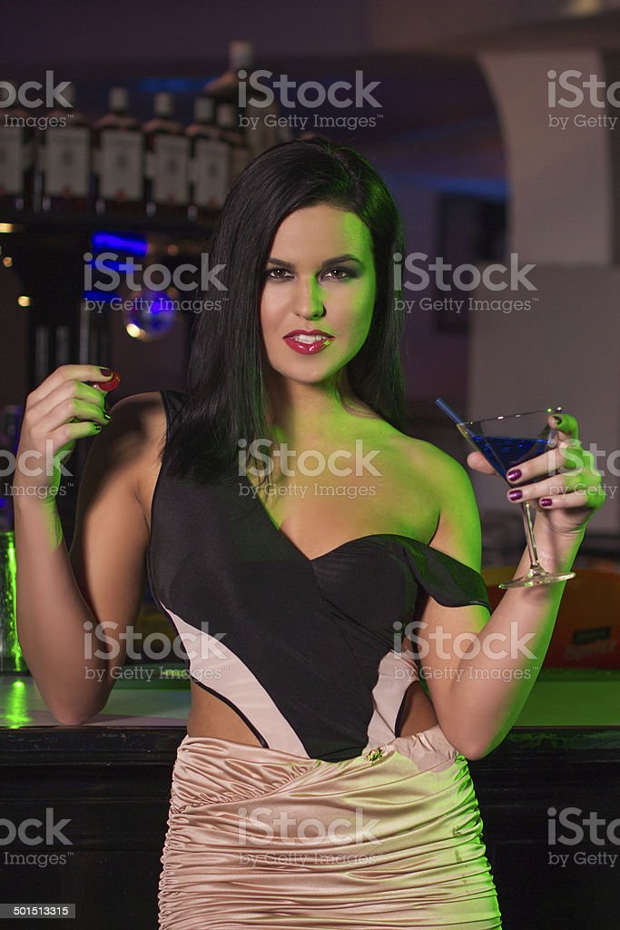 Woman with drink in bar royalty-free stock photo