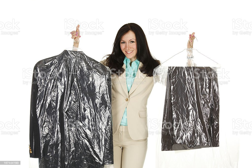 Woman with Dry Cleaned Clothes royalty-free stock photo
