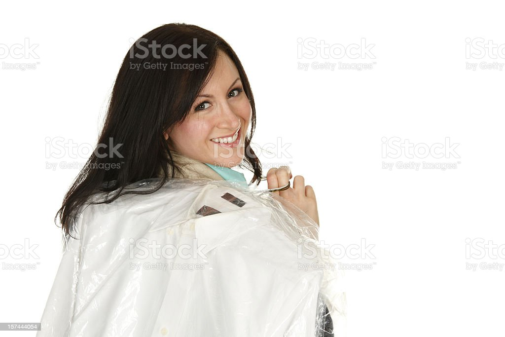 Woman with Dry Cleaning Over Shoulder royalty-free stock photo