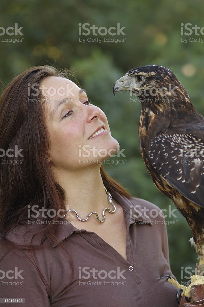 woman with eagle stock photo