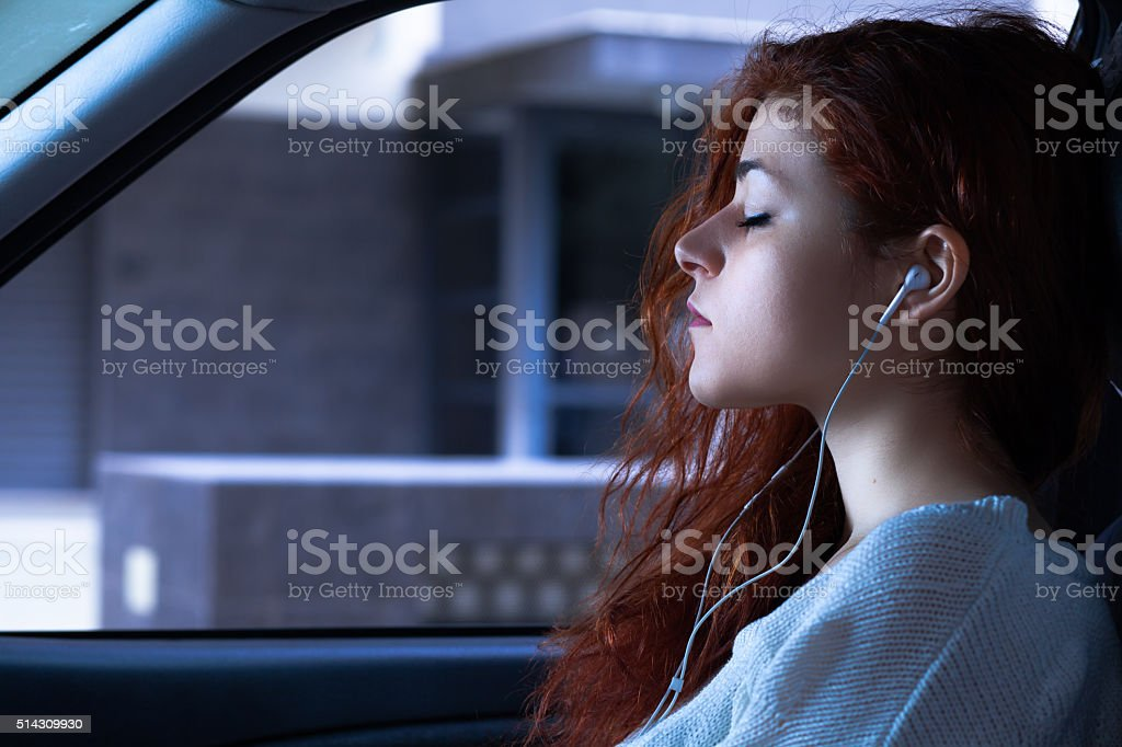 Woman with Earbuds stock photo