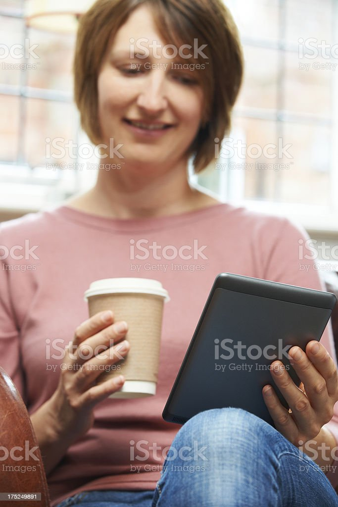 Woman With E-Book Reader In Cafe royalty-free stock photo