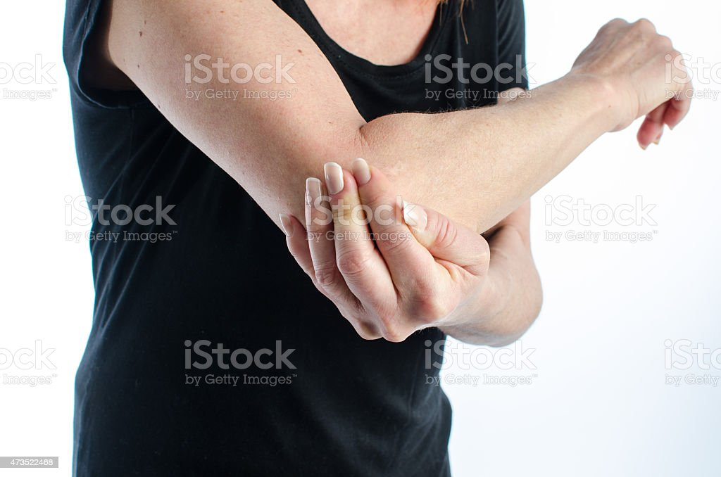 Woman with elbow pain stock photo