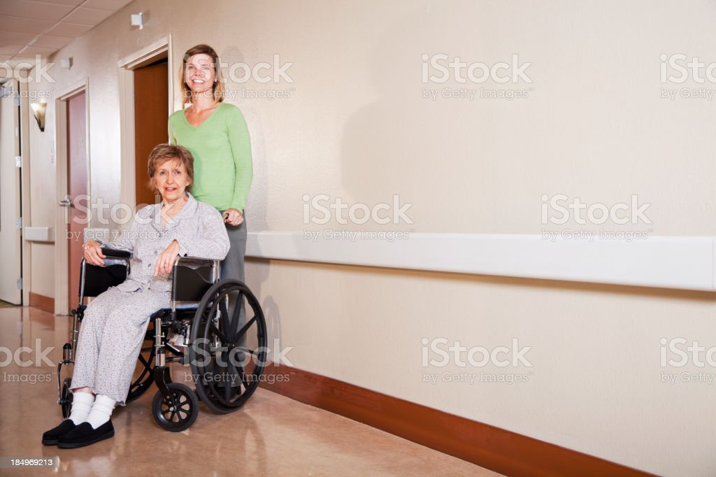 Woman with elderly mother in wheelchair royalty-free stock photo