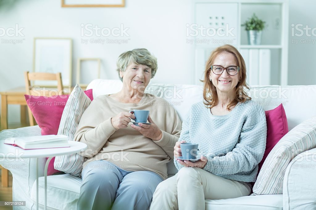 Woman with elderly mother stock photo