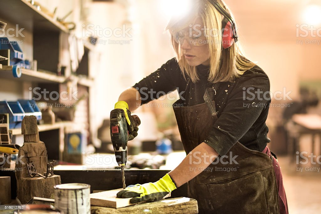 Woman with electric drill stock photo