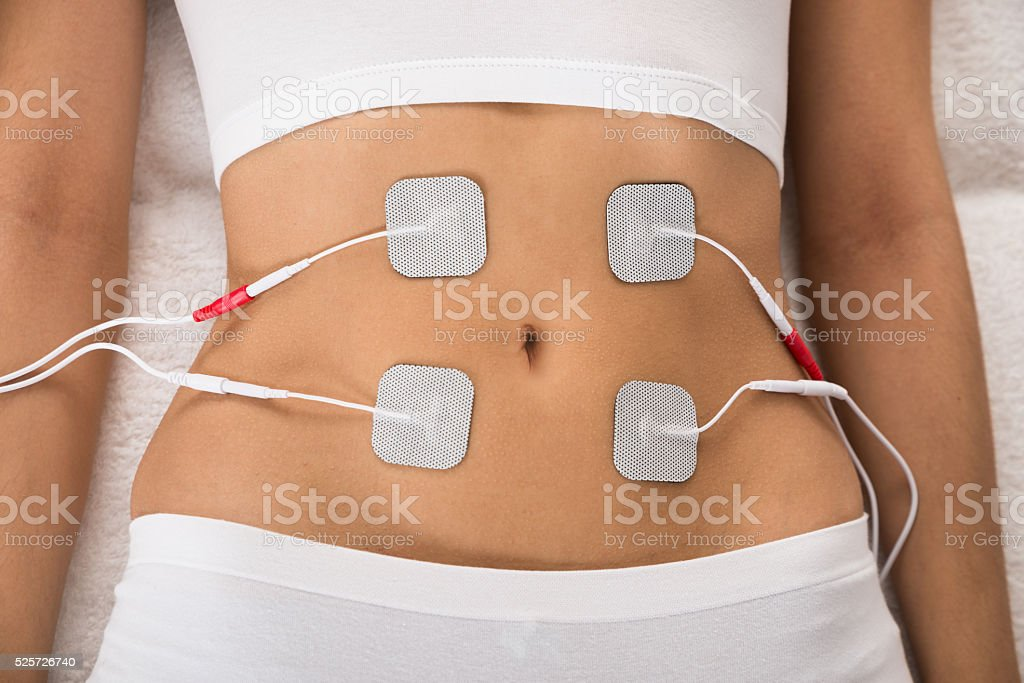 Woman With Electrodes On Her Stomach stock photo