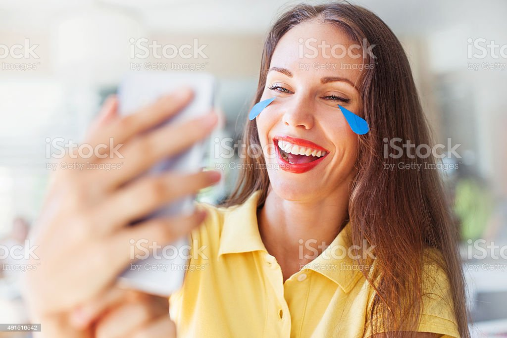 woman with 'emoji' style tear of her sad face stock photo
