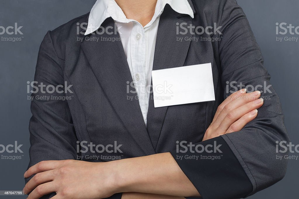 Woman with empty nametag, space for text stock photo