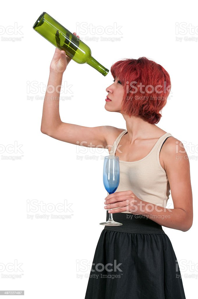 Woman with empty wine bottle stock photo