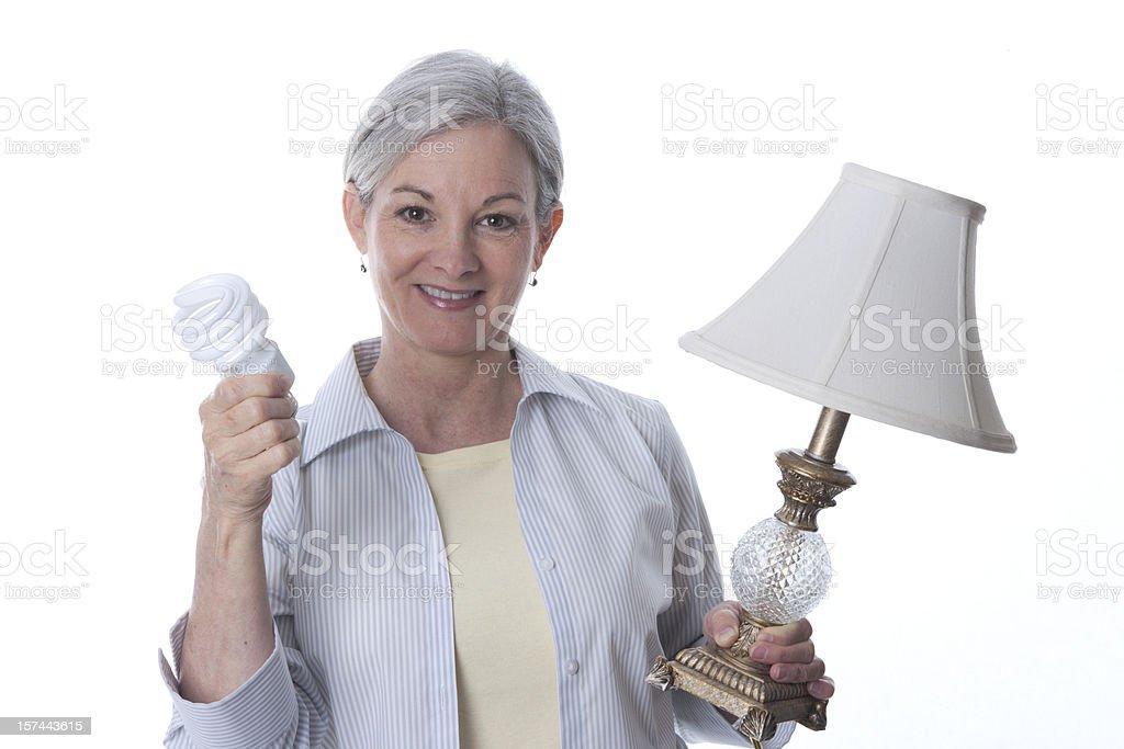 Woman with Energy Saving Lightbulb (XXL) royalty-free stock photo