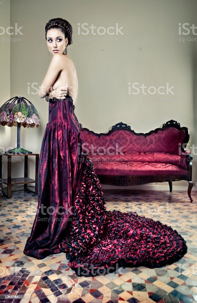 Woman with evening gown stock photo