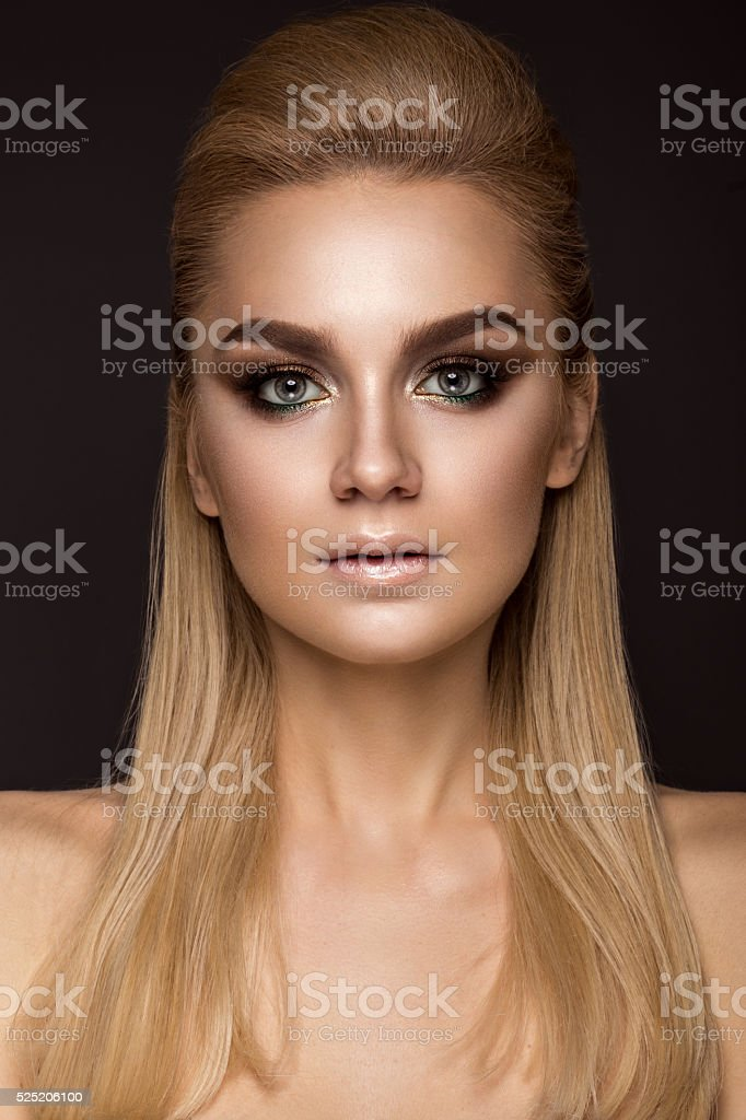 woman with evening makeup, long straight hair . Smoky eyes. stock photo