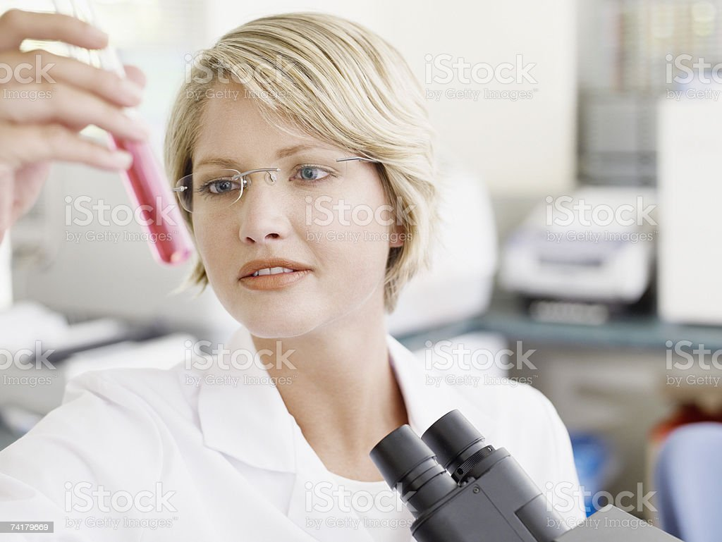 Woman with eyeglasses looking at test tube royalty-free stock photo