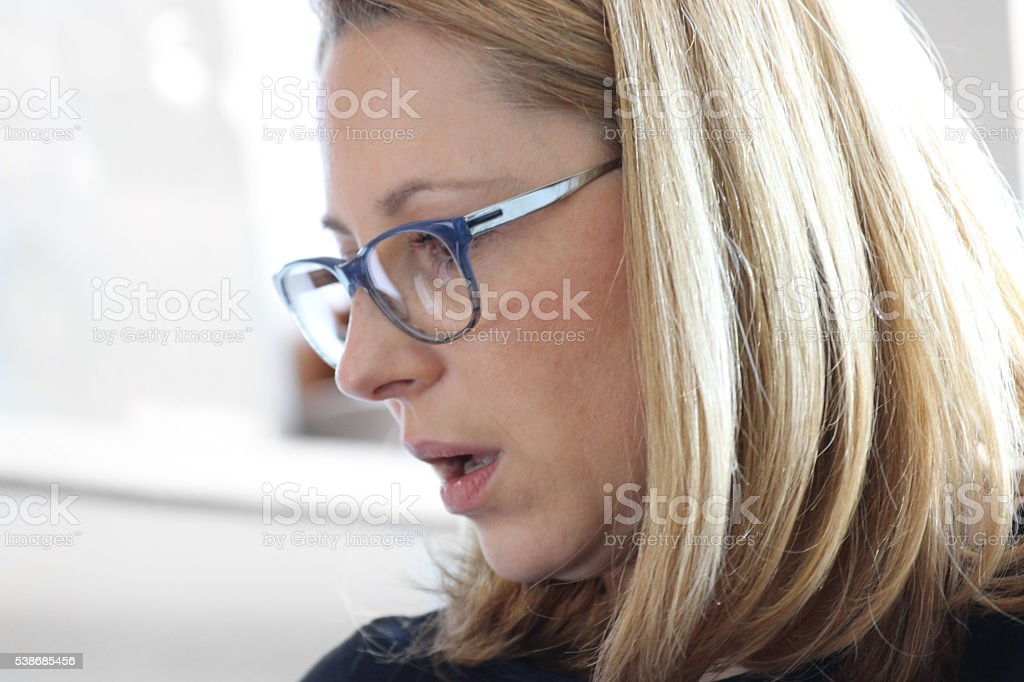 Woman with eyeglasses stock photo
